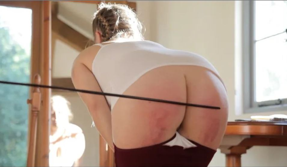 Very red bottom being caned to match the Maroon Regulation Knickers