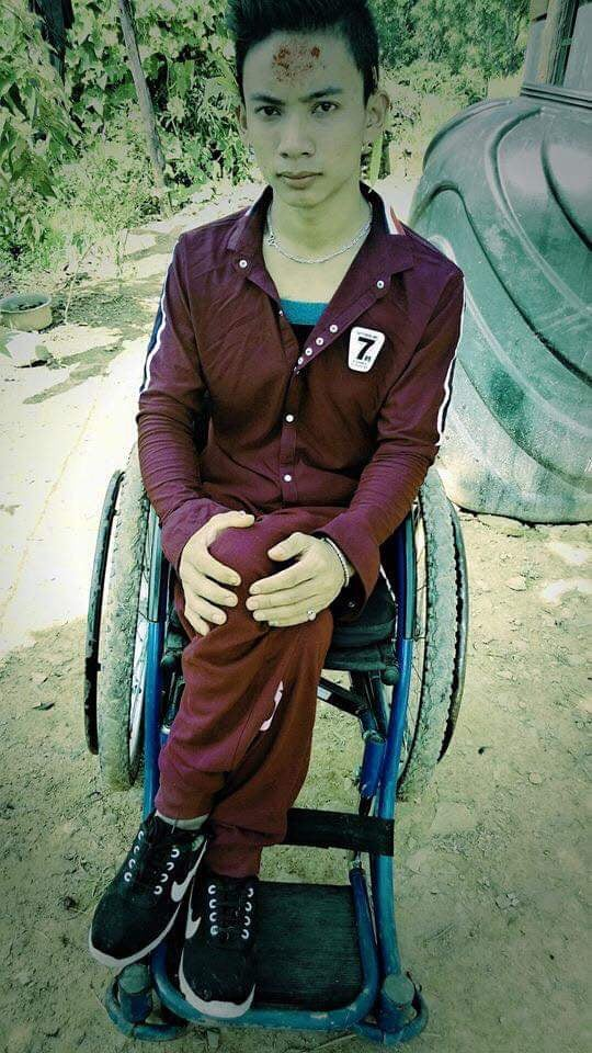 picture of Laxman in his wheel chair